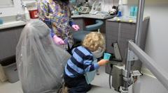 Little Boy In Dental Office Getting Teeth Cleaned Stock Footage