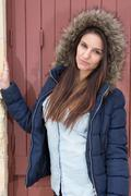 Attractive woman in false fur coat outside - stock photo