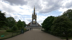 People walking by The Albert Memorial in Kensington Gardens in London - stock footage