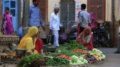 Indian women sell fruits and vegetables in the street of Jaisalmer,India. Stock Footage