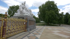 Tourists relaxing near The Albert Memorial in London - stock footage