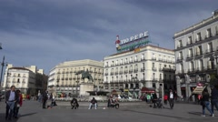 4K Tourist people visit Puerta del Sol Madrid Gate Sun crowded public square day Stock Footage
