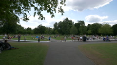 Children playing at Diana Princess Memorial Fountain in London Stock Footage