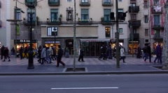 People walk along Rambla street at twilight time, slide trucking shot Stock Footage