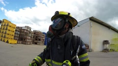 Firefighter dressing protective mask is ready to practice sealing of leaking con Stock Footage