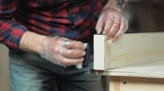 Man processes the wood protective fluid - stock footage