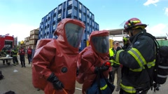 Firefighter dressing protective suite is ready to practice sealing of leakage Stock Footage