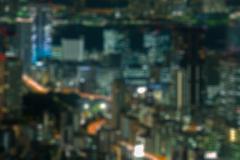 Night cityscape buildings blue orange bokeh blur defocused Stock Photos