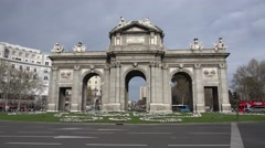 4K Famous Alcala Gate traffic car busy roundabout Madrid landmark symbol daytime Stock Footage