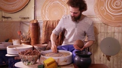 Fast motion video shot of a Potter working Stock Footage