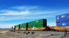 Train cars with containers Locomotive pushing in desert Stock Footage