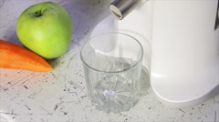 A glass of vegetable juice with a juice extractor. Stock Footage
