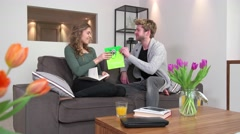 Couple At Home Man Giving Birthday Present Gift To Woman Stock Footage