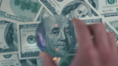 Cash banknote under the magnifying glass 03 Stock Footage