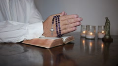 Man praying with rosary in hands and on top of Bible. Stock Footage