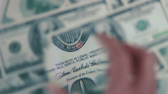 Cash banknote under the magnifying glass 08 Stock Footage