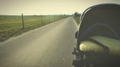 Taking a Walk with the Baby Stroller - stock footage