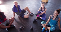 Group of multi-ethnic friends recovering and hydrating at the gym - stock footage