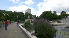 Adults walking and kids running in the Italian Gardens in London - stock footage