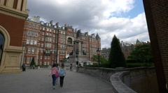 Tourists walking near Prince Albert Statue in London Stock Footage