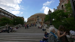 Tourists relaxing on stairs in front of the Royal Albert Hall, London Stock Footage