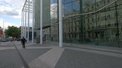 People walking by the Imperial College Business School in London Stock Footage