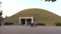 Tourists at the entrance of Heavenly Horse Tomb at the Gyeongju Tumuli Park Stock Footage