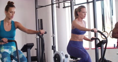 Multi-ethinc friends on indoor cycling during a crossfit training class Stock Footage
