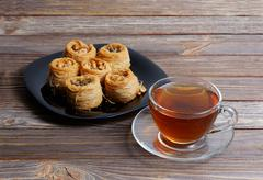 Eastern sweets and cup of tea Stock Photos
