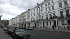 Cars on Exhibition Road in London Stock Footage