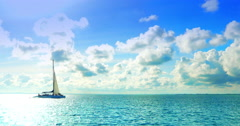 4K Catamaran BoatSailing on Tropical Turquoise Blue Sea, Sun and Clouds in Backg Stock Footage