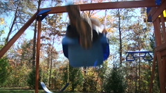 Little Boy On Swing Set Stock Footage