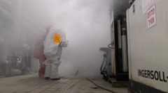 Firefighters practice sealing of toxic Ammonia leak accident Stock Footage