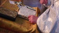Orthodox priest reads Scripture - stock footage