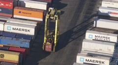 Containers and straddle carrier. Generic port activety. From Helicopter - stock footage