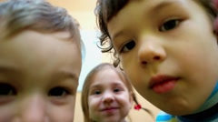 Beautiful little children friendly waving his hand to the camera hello. Stock Footage