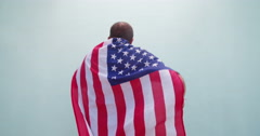 American Patriot posing and dancing with flag Stock Footage