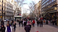Many people stroll at Les Rambles, february weather, overhead view, glide shot - stock footage