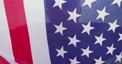American Patriot posing and hiding behind flag - stock footage