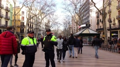 POV camera walk at crowded Les Rambles, police officers on the way, many people Stock Footage