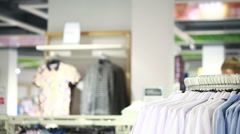 Portrait of a handsome young man shopping for clothes at shop Stock Footage