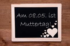 Blackboard With Hearts, 8 Mai Muttertag Means Happy Mothers Day - stock photo