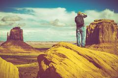Caucasian Nature Photographer in Monuments Valley Arizona, United States. - stock photo