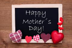 Blackboard With Textile Hearts, Text Happy Mothers Day - stock photo