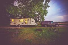 RV Camping Adventure. SUV Pulling Travel Trailer. Camper Journey. - stock photo