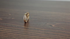Wedding rings on the table rotation Stock Footage