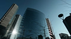 Skyscrapers in Porta Nuova, the new business district of Milan, Italy, pan Stock Footage