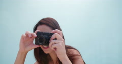 Middle-aged woman taking photos Stock Footage