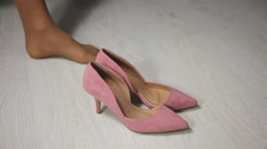 Woman wears pink shoes Stock Footage