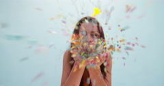 Close up view of a woman blowing confetti Stock Footage